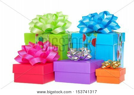 Many brightly colored boxes presents with colorful bows. Holiday shopping wrapped. Isolated on a white background.