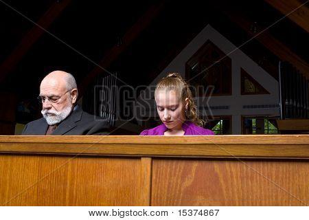 Senior Man Young Woman Sitting Head Bowed Praying Church Pew