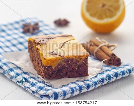 Thanksgiving treatment. Marble chocolate brownies with pumpkin. Freshly baked homemade brownie. Selective focus on the front. Horizontal.