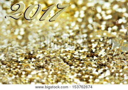 2017 writen on golden and bright confettis background