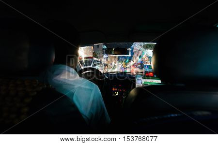 Hanoi Vietnam - September 20 2016: Low key photo of looking out from Vietnam taxi to busy night traffic of Hanoi's down town.