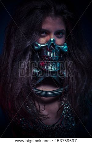 Halloween costume, brunette girl with metallic skull mask