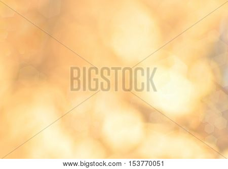 Abstract yellow background. Some light reflexions and lens hectagons spots visible.