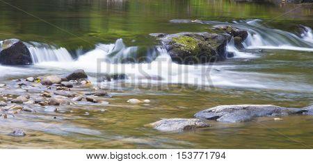 Wilson Creek water turning white as it runs over rocks