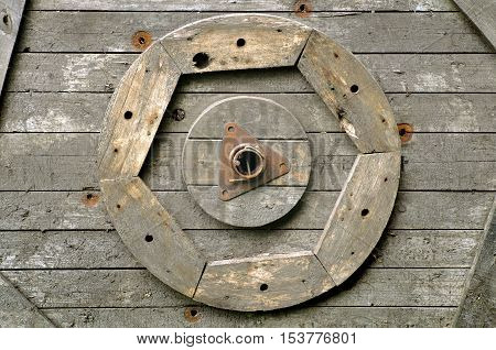 Vintage wood background texture. Boards carved in the shape of a wheel and the gear.