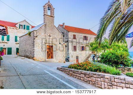 View at old stone architecture in Island Brac, Bol town, Croatia Europe touristic destination.