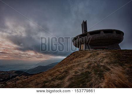 Cloudy sunset at Buzludzha monument, near the town of Kazanlak, Bulgaria