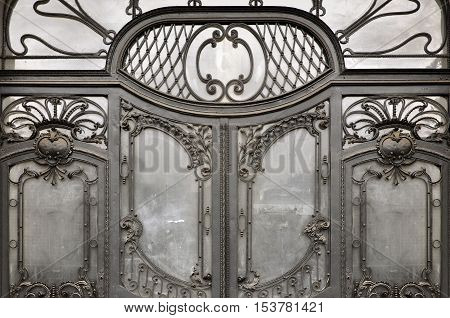 Wroclaw, Poland - April 10, 2016: The entrance door to the Art Nouveau style. Elegant metal forged patterns and glass filling. Wroclaw, Poland