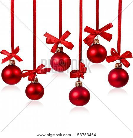 Hanging red christmas balls with red ribbon bows isolated on a white background