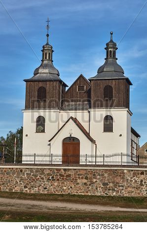 rural parish church with wooden belfry in Poland