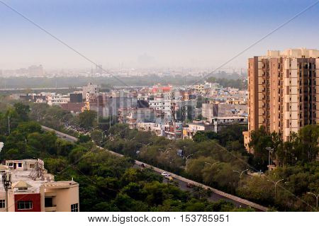 Noida, Jaipur - 16th Nov 2016 : Multiple buildings co exist with the greenery in Noida and the surrounding areas. The millennium city is being added onto at a rapid pace
