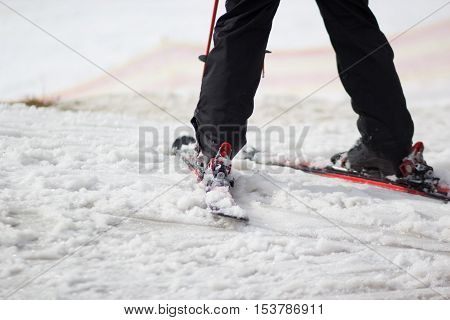 legs of skier on a loose snow hills