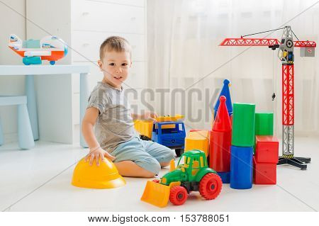 A boy plays in the builder in the room