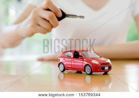 small car and key for car car leasing and car loan concept