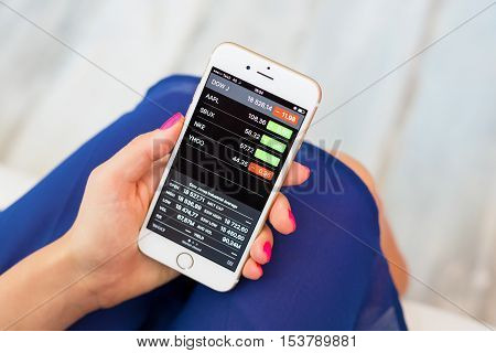 RIGA LATVIA - SEPTEMBER 8 2016: Apple Stocks app on iPhone lets users to keep track of their investment portfolio.