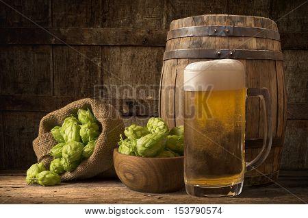 Beer keg with glasses of beer on rural