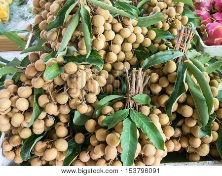 Group of fresh longan for sale in market.