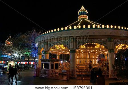 colorful merry go round at night time