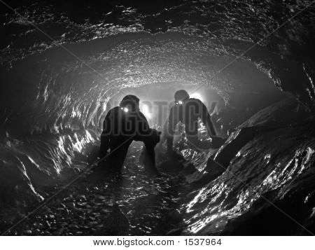 Two Cavers In A Beautiful Passage