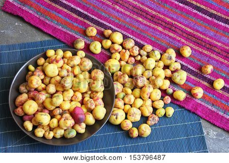 Bowl of colorful whole raw Peruvian olluco tuber vegetable