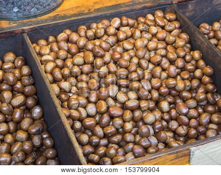 Group of Roasting chestnuts for sale in market.