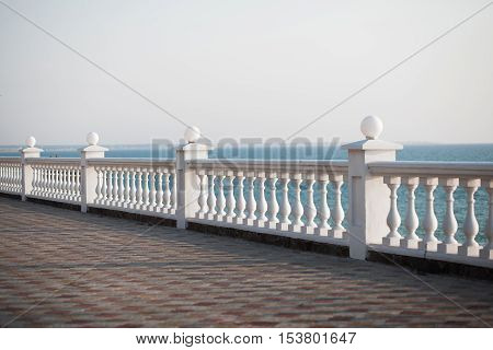 Balcony view on the sea shore on a sunny day. Summer