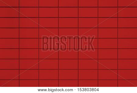 View of a red tiled background with black pointing