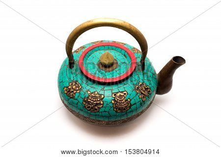 Old copper kettle with natural turquoise. Isolated
