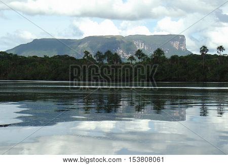 Nonoy Tepuy reflected on the waters of the Canaima Lagoon in Canaima National Park in Venezuela's Gran Sabana