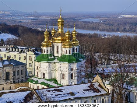 All Saints' Church of Kiev Pechersk Lavra Monastery in winter. Ukrainian Baroque, 17th century. The Dnieper River behind