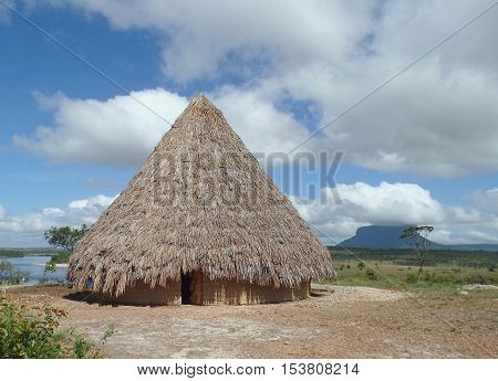 Native landscape. native home built with mud and straw on the coast of the river Carrao, in the Venezuelan Gran Sabana, Canaima National Park