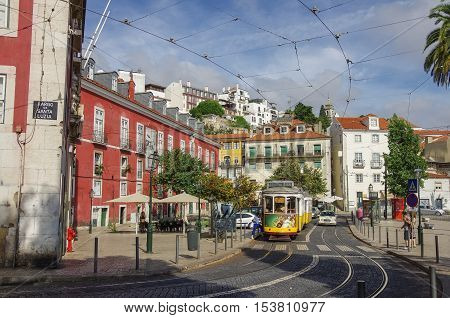 Lisbon, Portugal - March 7, 2010: Old tram in Alfama district in Lisbon historic center . Portugal