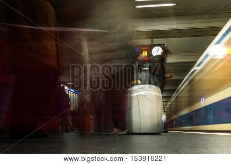 Highlighted Luggage Suitcase Pack Silver Travel Train Station Arrival Departure Boarding Crowd Long Exposure Movement Underground Subway