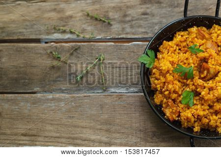 traditional spanish paella rice with chichen and meat on pan