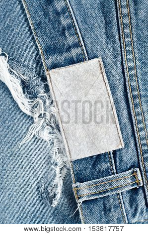 Jeans Background Texture,blank Real Leather Jeans Label Sewed On Old Worn Jeans.denim Jeans Texture