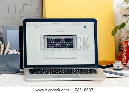 PARIS FRANCE - OCT 28 2016: Apple Computers website on new MacBook Pro Retina with OLED touch bar in a geek creative room showcasing new professional laptop - 15 inch model with touch bar seen from above