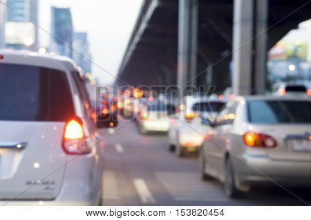 transportation vehicle and traffic concept - Blurred  empty space between car lane with traffic jam in evening light
