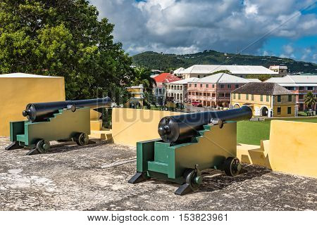Two vintage cannons on the fort wall facing the town.