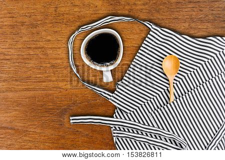 Cup Of Coffee And Kitchen Utensils In Pocket Of Apron