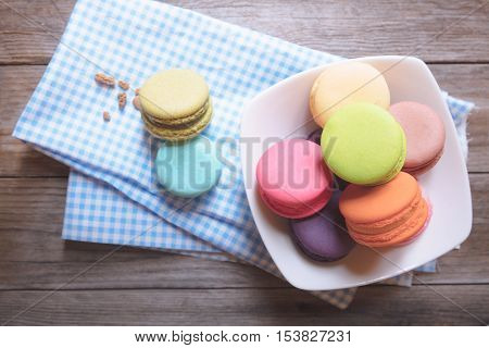 Closeup colorful macarons or macaroons, Food background