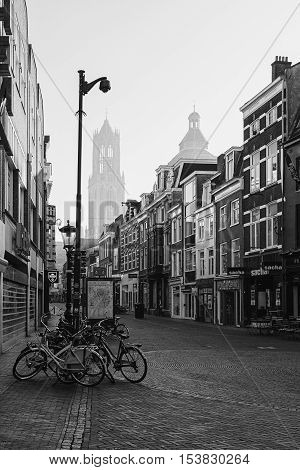 Utrecht Netherlands - October 23 2016: The shopping street Zadelstraat in the old town of Utrecht and in the background the Dom Tower.