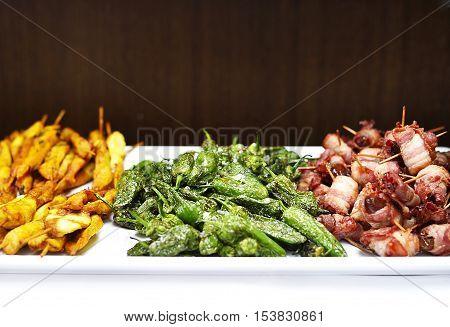 Fresh grilled antipasto or tapas, italian cuisine or spanish cuisine, close up shot.