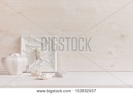 Soft home decor; shells and corals on white wooden background. Interior.