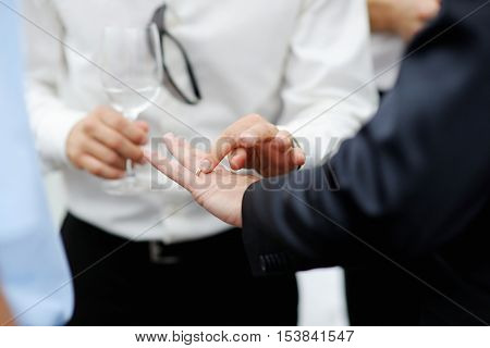 Groom Showing His Wedding Ring