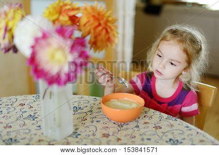 Little Girl With A Spoon Of Porridge