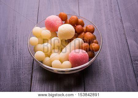 Bangladesh or kolkata's or India's favourite sweet rasgulla, chamcham and gulab jamun, dry rasgulla, bengal sweets, made of milk / khoya, sweet meets, extreme closeup