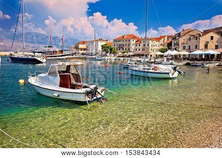 Turquoise beach and harbor of Postira village island of Brac Dalmatia Croatia