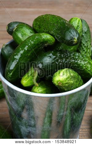 bucket filled with gherkins close up shallow dof