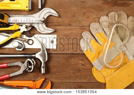 Hand tools and gloves on a workbench