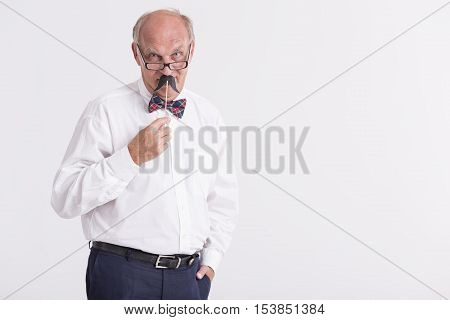 Elder elegant man with glasses dicky bow and paper moustache